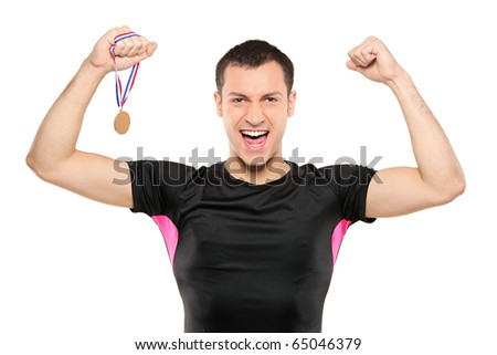 Young happy sportsman holding a gold medal isolated on white background - stock photo