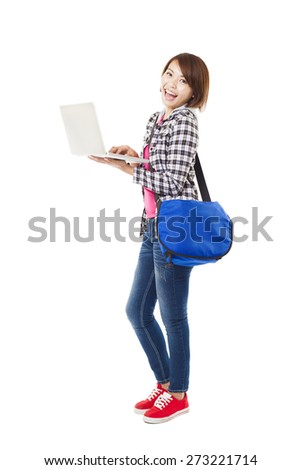 Young happy  student with laptop and isolated on white - stock photo