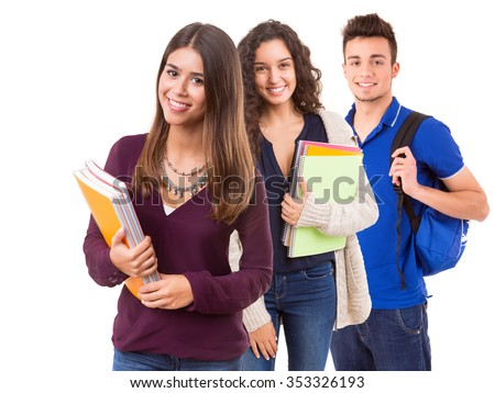 Young happy students posing over white background