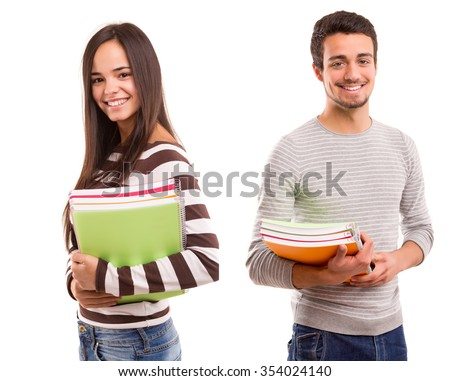 Young happy students posing over white background - stock photo