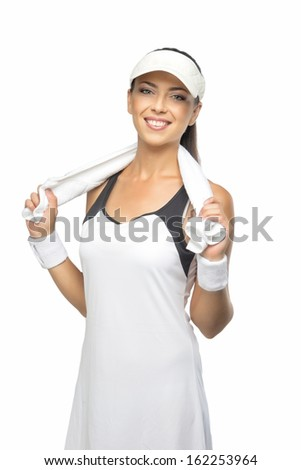 Young Happy Tanned Caucasian Female Tennis Player Equipped with Professional Tennis Outfit with Towel on Shoulders. Isolated on White. Vertical Image