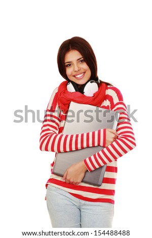 Young happy teen girl holding laptop isolated on white - stock photo