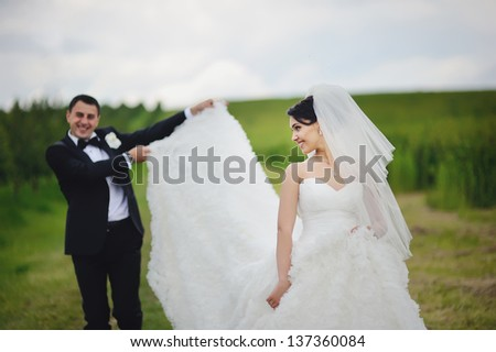 young happy wedding couple having fun - stock photo
