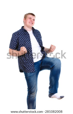 Young happy winning man with the foot bent in a knee and clenched his fists Studio shot. isolated on white background. positive human emotion, facial expression - stock photo