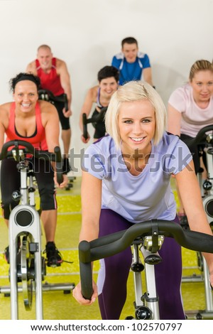 Young happy woman at class enjoy gym workout