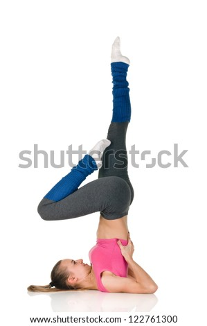 young happy woman does fitness exercise on white background exercise birch - stock photo