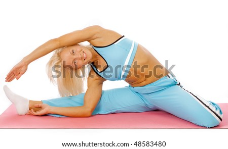 Young happy woman doing fitness exercises