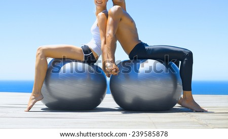 Young happy woman doing fitness exercises on the ball - stock photo