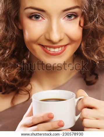 young happy woman drinking coffee