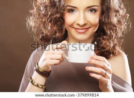 young happy woman drinking coffee - stock photo
