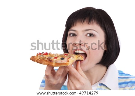 Young happy woman eating pizza, isolated on white. portrait of young woman holding piece of pizza.