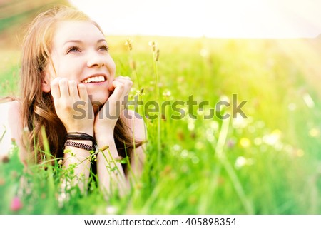 Young, happy woman enjoy a sunny day - stock photo