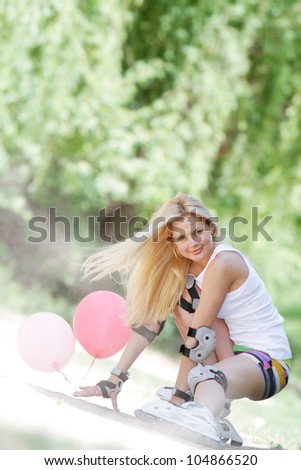young happy woman enjoying roller skating / blading on natural background - stock photo