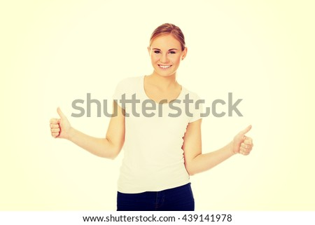 Young happy woman gesturing thumbs up - stock photo