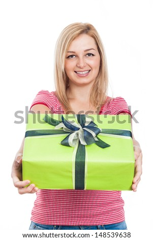 Young happy woman giving present, isolated on white background. - stock photo