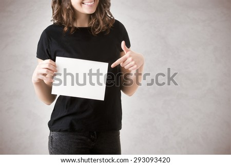 Young happy woman holding a blank business card on a white background - stock photo