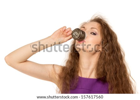 Young happy woman holding a coffee cup isolated on white background