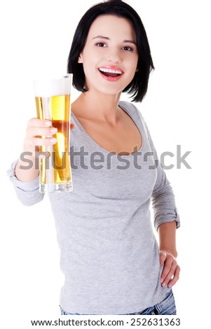 Young happy woman holding a glass of beer.