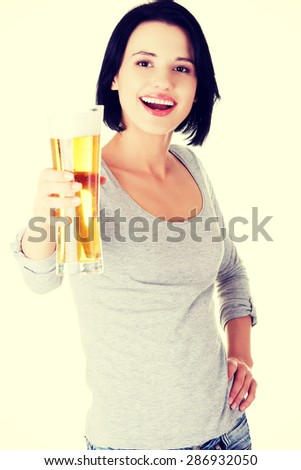Young happy woman holding a glass of beer. - stock photo