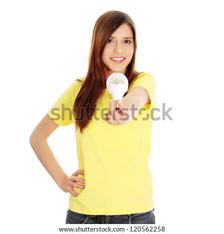 Young happy woman holding diode bulb, isolated on white - stock photo