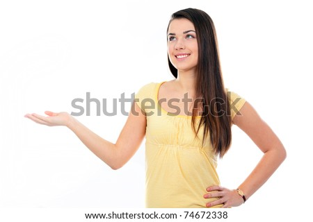 Young happy woman holding her hand palm up, ready to hold your product.