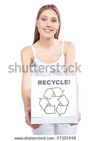 Young happy woman holding recycling waste box. - stock photo