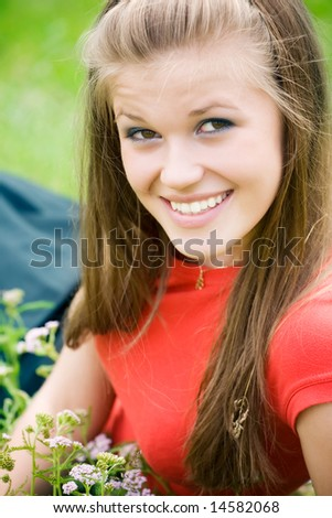 Young happy woman in green grass. - stock photo