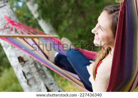 Young happy woman in hammock - stock photo