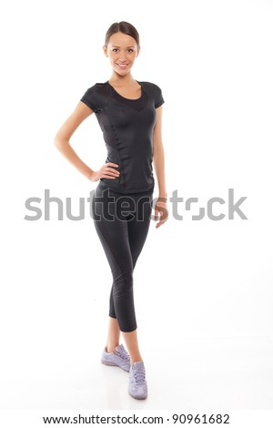 Young happy woman in sports wear - stock photo