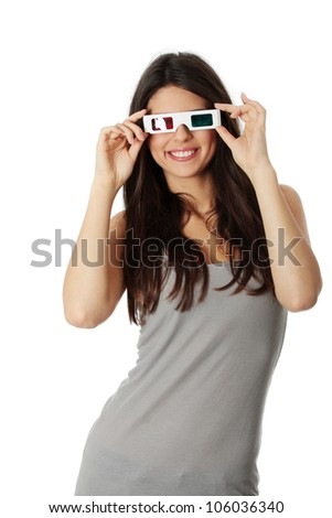 Young happy woman is watching 3D movie. Pretty girl is smiling and holding glasses. Isolated on the white background. - stock photo