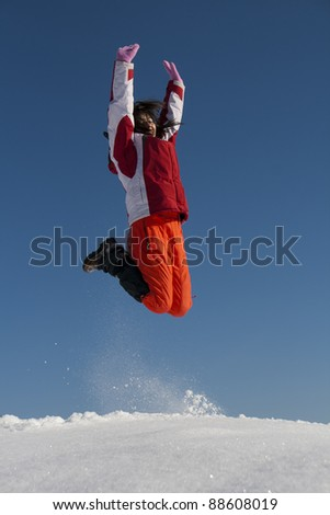 Young happy woman jumping outdoor in sunlight - stock photo