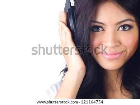 Young happy woman listening to music on white isolated