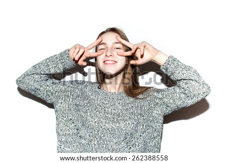 Young happy woman looking at camera. Young  happy girl hipster. Portrait of trendy girl having fun.   - stock photo
