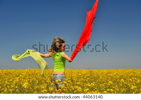 young happy woman on field in summer