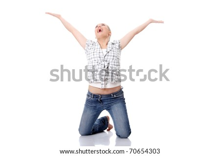 Young happy woman on knees, with hands up, isolated on white - stock photo