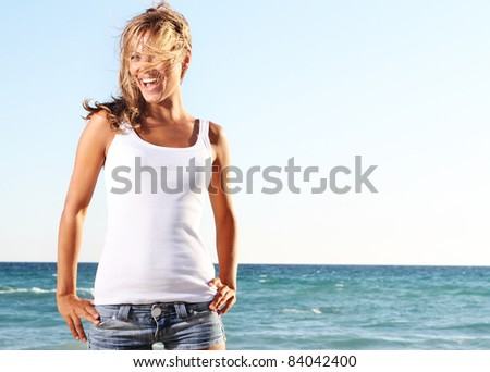 young happy woman on sea background - stock photo