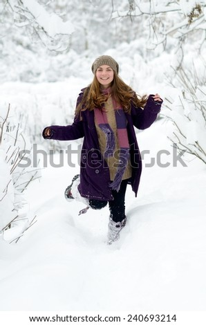 young happy woman outdoor in winter enjoying the snow - stock photo