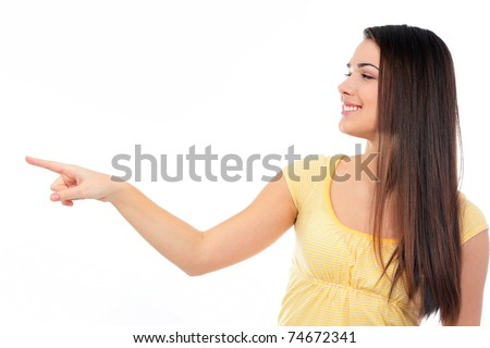 Young happy woman pointing to the side at copyspace
