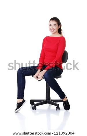 Young happy woman sitting on a wheel chair, isolated over a white background - stock photo