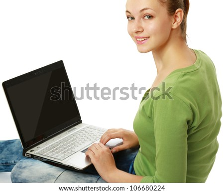 Young happy woman sitting with a laptop , isolated on white background - stock photo