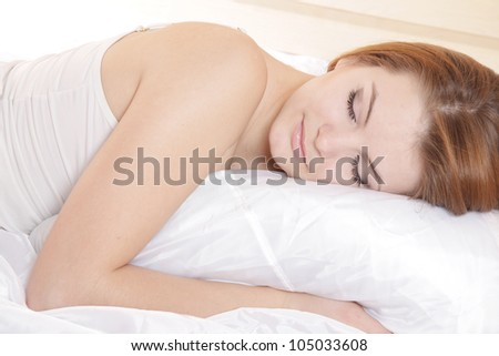 young happy woman sleeping - stock photo