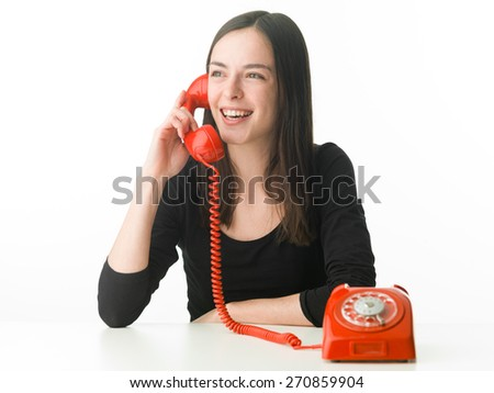 young happy woman talking on the phone - stock photo
