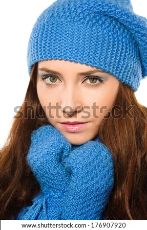 Young happy woman wearing winter cloth, isolated over white