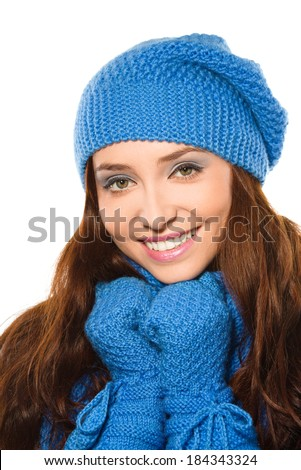 Young happy woman wearing winter cloth, isolated over white - stock photo