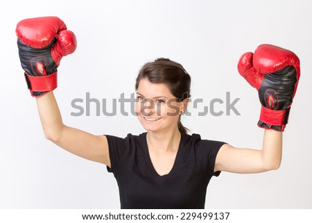 Young happy woman winner of a boxing championship - isolated on white