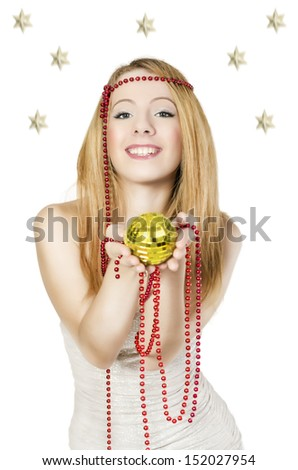Young happy woman with a disco ball in her hands.