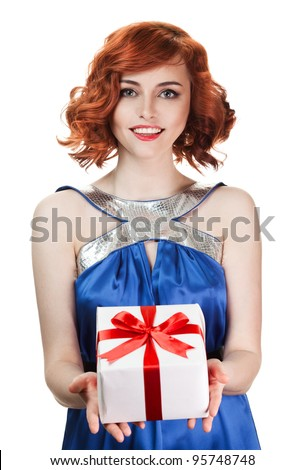 Young happy woman with a gift - stock photo