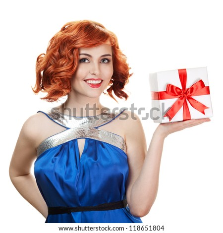 Young happy woman with a gift. Isolated over white - stock photo