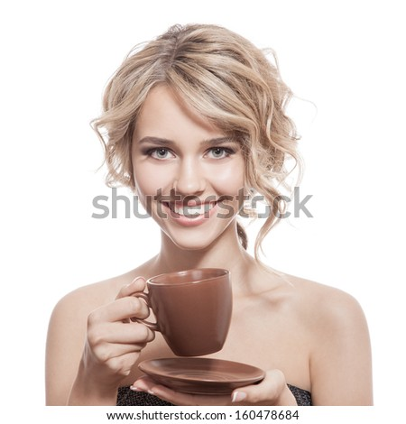 Young happy woman with an aromatic coffee in hands. Isolated - stock photo