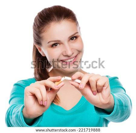 Young happy woman with broken cigarette. Stop smoking concept. - stock photo